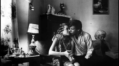 Danny Lyon. USA. Chicago. 1965. Uptown, the kiss. Inside Kathy's apartment. Magnum Photos.