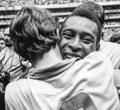 Pelé celebrates Brazil's triumph with Ado, one of the squad's reserve goalkeepers. © Allsport-Getty Images