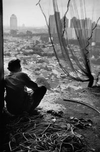 Sebastião Salgado. Most construction workers are migrants from rural areas, they live on the construction sites. Jakarta, Indonesia. 1996.