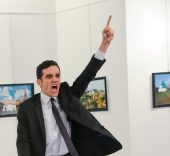 Burhan Ozbilici. An unnamed gunman gestures after shooting the Russian Ambassador to Turkey, Andrei Karlov, at a photo gallery in Ankara, Turkey, Monday, Dec. 19, 2016. AP Photo/Burhan Ozbilici.