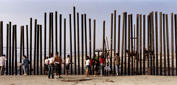 © Kai Wiedenhöfer. The very end of the Mexican-US border running into the Pacific Ocean in Tijuana, Mexico. November 2008.