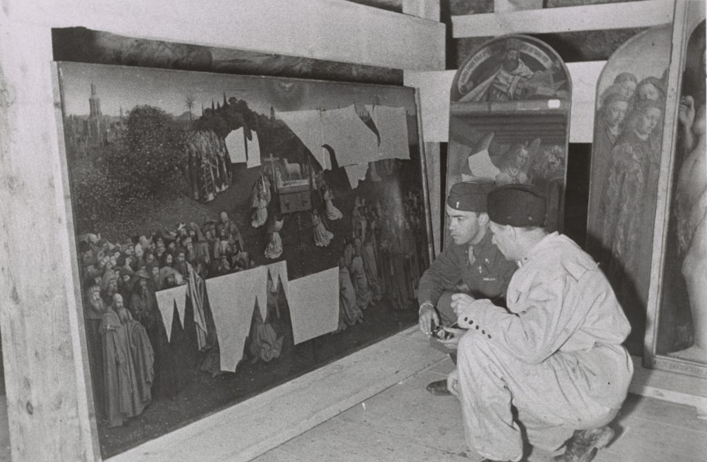 Lt. Daniel J. Kern and German conservator Karl Sieber examining Jan van Eyck's Adoration of the Mystic Lamb, also known as the Ghent Altarpiece (1432). Thomas Carr Howe papers, Archives of American Art, Smithsonian Institution.